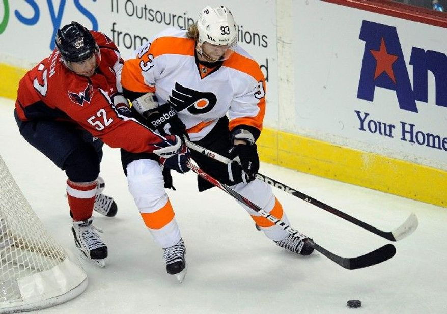 Defenseman Mike Green (52), an offensive force in recent seasons, has just one assist in 20 games since returning from a sports hernia operationa. (Associated Press)