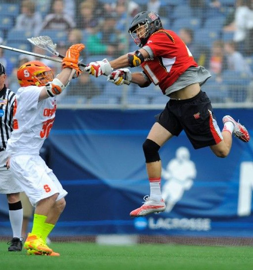 Maryland midfielder Kevin Cooper (right), shown in last season's NCAA tournament, has three goals and six assists in helping the 12th-ranked Terrapins to a 5-3 start this season. (Associated Press)