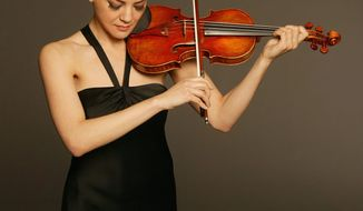 "** FILE ** Concert violinist Anne Akiko-Meyers has a ""Royal Spanish"" Stradivarius with a ""masculine"" timbre and recently acquired ""Molly,"" which she says has a ""feminine sound."" Her recent recording of Bach's double violin concerto, playing both solo parts on each her two violins, captures this difference. (Photograph by Anthony Parmelee)"