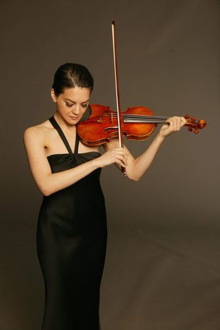 """** FILE ** Concert violinist Anne Akiko-Meyers has a """"Royal Spanish"""" Stradivarius with a """"masculine"""" timbre and recently acquired """"Molly,"""" which she says has a """"feminine sound."""" Her recent recording of Bach's double violin concerto, playing both solo parts on each her two violins, captures this difference. (Photograph by Anthony Parmelee)"""