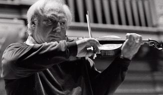 """Isaac Stern preferred his two Guarneris to a Stradivarius, his widow says, but considered his contemporary instruments made by New York's Samuel Zygmuntowicz to be of equal quality. """"He liked to see if people could tell the difference,"""" she said. They usually couldn't. (Associated Press)"""