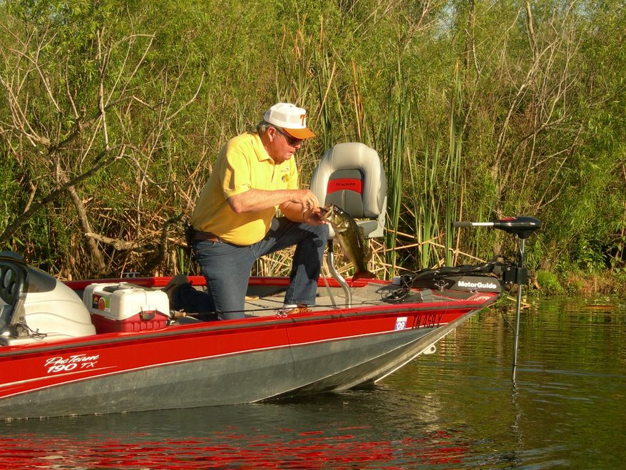 TV fisherman Bill Dance shows off one of his catches. Tennessee tourism officials are stressing the state's outdoor activities, including fishing, hunting, hiking and camping. A trip with Mr. Dance is a prize in one of several state-sponsored outdoor-adventure contests. (Photo provided by Tennessee Department of Tourist Development)