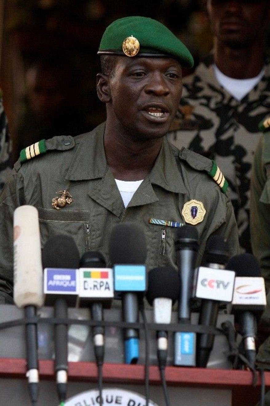 Coup leader Capt. Amadou Haya Sanogo speaks at junta headquarters in Kati, on the outskirts of Bamako, Mali, on Tuesday. (Associated Press)