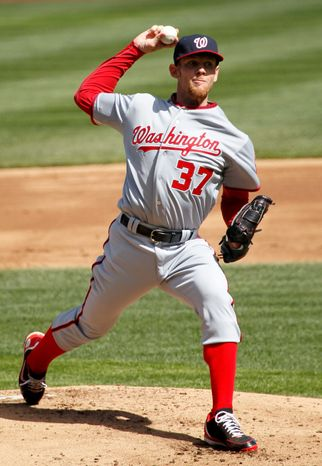 Stephen Strasburg worked seven innings, allowing one run on five hits. He walked one and struck out five but didn't get the decision in the Nationals' 2-1 win. (AP Photo/Charles Rex Arbogast)