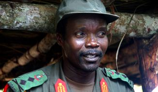 ** FILE ** Joseph Kony, leader of the Lord's Resistance Army, meets in July 2006 with a delegation of 160 officials and lawmakers from northern Uganda and representatives of non-governmental organizations in Congo near the Sudan border. (Associated Press)
