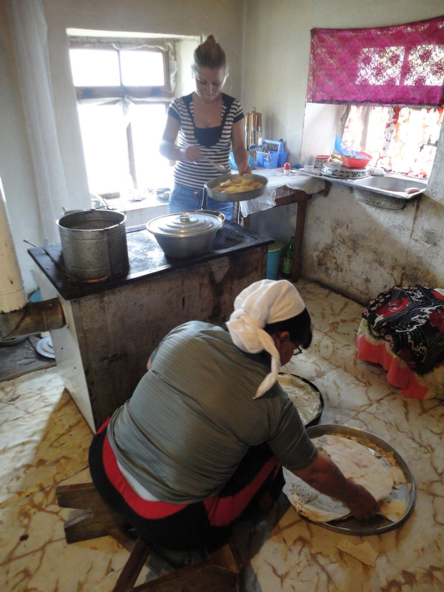 Shepherd Anastas Karaj's wife and daughter prepare baklava at the family's home in Selta, Albania. (Eckehard Pistrick/Special to The Washington Times)