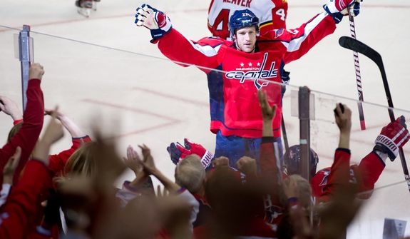 Washington Capitals center Brooks Laich (21) celebrates goal in the second period to make it 3-0 as the Washington Capitals take on the Florida Panthers in National Hockey League hockey at the Verizon Center, Washington, D.C., Thursday, April 5, 2012. (Andrew Harnik/The Washington Times)