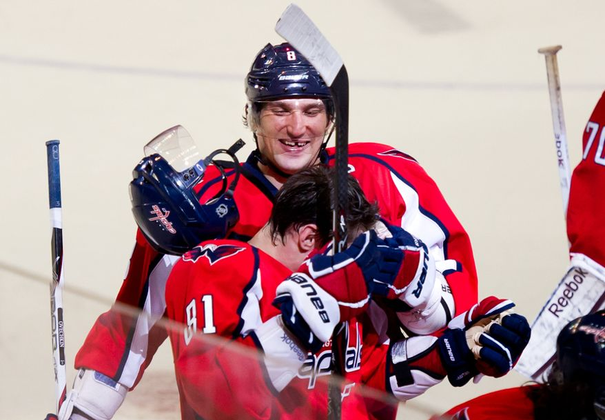 Washington Capitals left wing Alex Ovechkin (8), above, playfully knocks the helmet of Washington Capitals defenseman Dmitry Orlov (81) of as the team celebrates their 4-2 victory over the Florida Panthers in National Hockey League hockey at the Verizon Center, Washington, D.C., Thursday, April 5, 2012. (Andrew Harnik/The Washington Times)