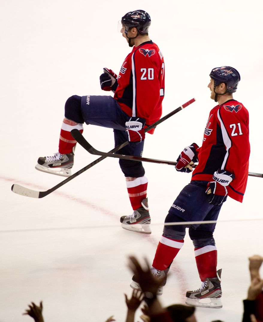 Washington Capitals left wing Troy Brouwer (20) and Washington Capitals center Brooks Laich (21) celebrates their 4-2 victory over the Florida Panthers in National Hockey League hockey at the Verizon Center, Washington, D.C., Thursday, April 5, 2012. (Andrew Harnik/The Washington Times)