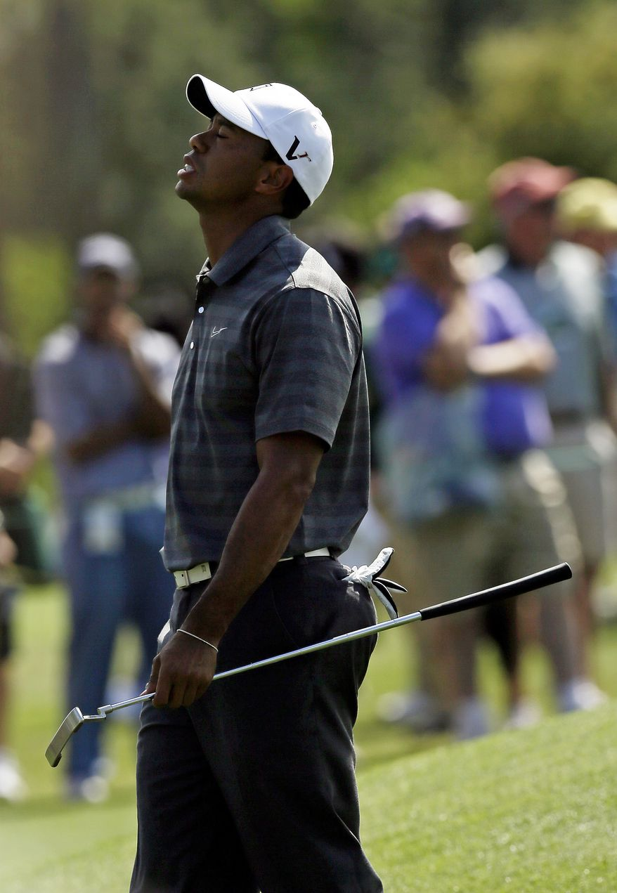 Tiger Woods react after his bogie on the 17th hole during the first round the Masters golf tournament Thursday, April 5, 2012, in Augusta, Ga. (AP Photo/David J. Phillip)