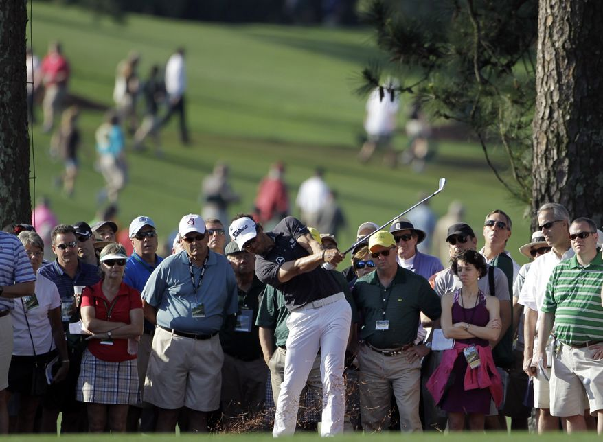Adam Scott hits on the first fairway during the first round of the Masters golf tournament in Augusta, Ga., on April 5, 2012. (Associated Press)