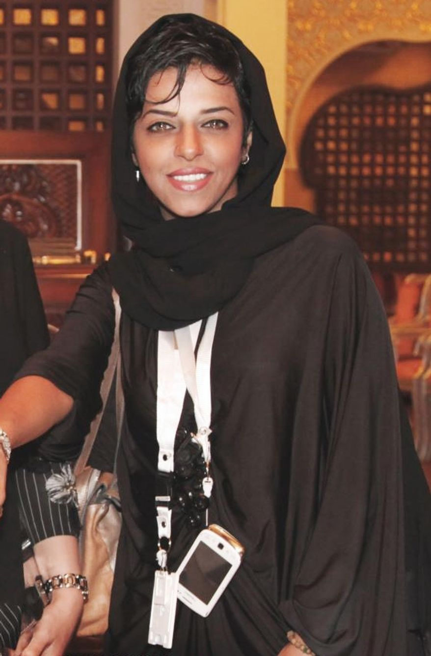 In this undated photo, Reema Abdullah, striker of Jeddah Kings United all female team, poses in Jeddah, Saudi Arabia. Abdullah, Saudi Arabian female sports commentator and an amateur football player in the ultraconservative Muslim country, says she will be one of the 8,000 people who will carry the Olympic flame for the 2012 London Games. (Associated Press/Reema Abdullah)