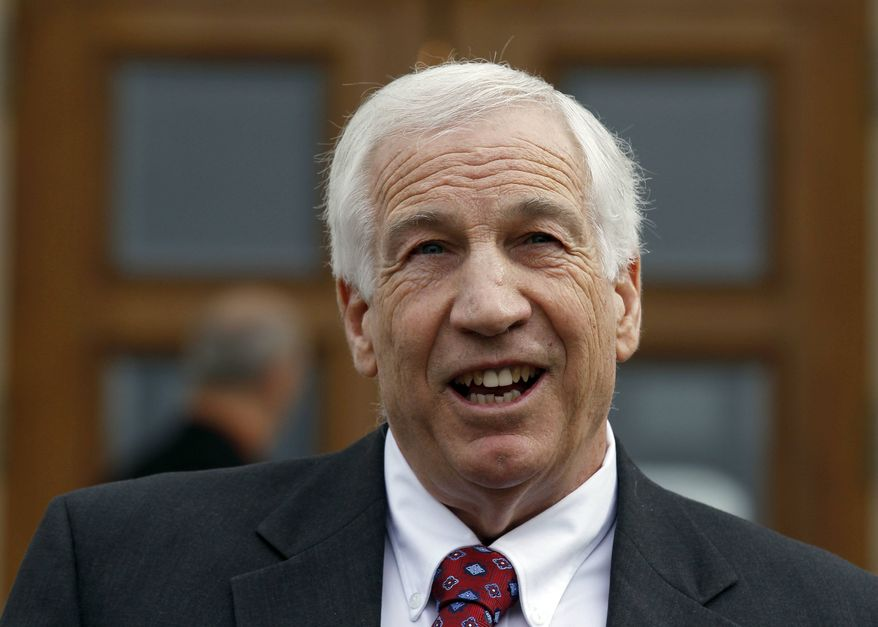** FILE ** Jerry Sandusky, a former Penn State assistant football coach charged with sexually abusing boys, speaks to the media at the Centre County Courthouse after a bail conditions hearing in Bellefonte, Pa., on Friday, Feb. 10, 2012. (AP Photo/Alex Brandon)