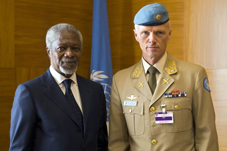 Former U.N. Secretary-General Kofi Annan (left), the U.N.-Arab League special envoy to Syria, poses with Maj. Gen. Robert Mood of Norway before a meeting at the European headquarters of the United Nations in Geneva on Wednesday, April 4, 2012. Gen. Mood is heading a planning team for a possible deployment of a U.N. supervision and monitoring mission in Syria. (AP Photo/Keystone/Martial Trezzini)