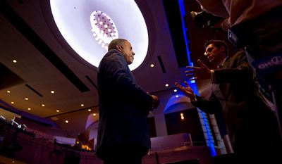 "Roy ""Chip"" Ellis, President and C.E.O of Ellis Development Group, center, speaks to a television news crew about the redesigned historic Howard Theatre which is set to reopen with a ribbon cutting Monday and an opening night gala on Thursday, Washington, D.C., Thursday, April 5, 2012. (Andrew Harnik/The Washington Times)"