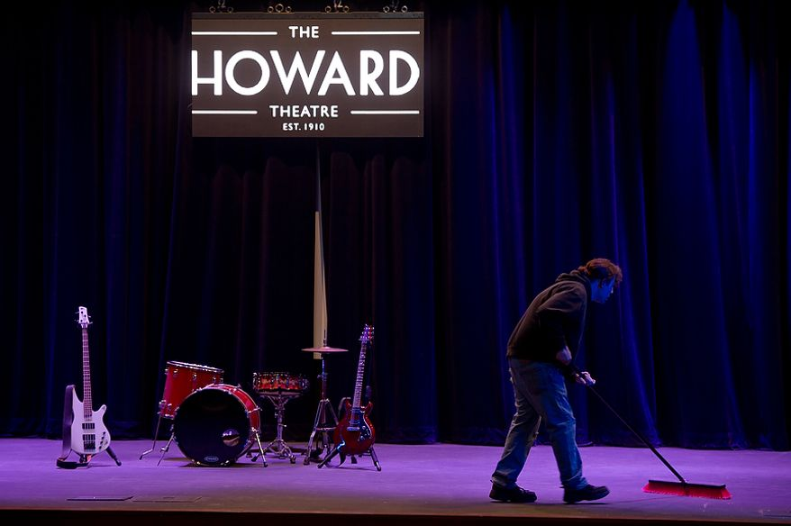 A worker sweeps the stage of the redesigned historic Howard Theatre which is set to reopen with a ribbon cutting Monday and an opening night gala on Thursday, Washington, D.C., Thursday, April 5, 2012. (Andrew Harnik/The Washington Times)