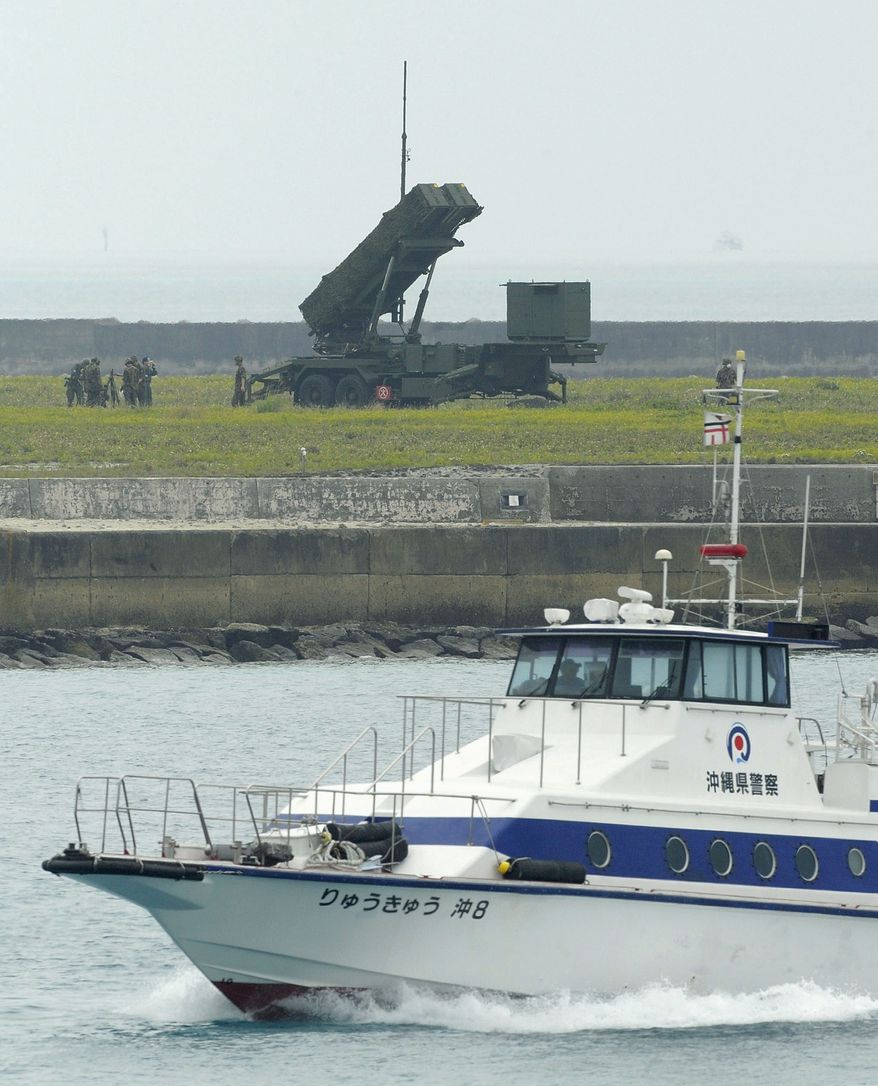 A police boat patrols near one of Japan's PAC-3 Patriot missiles, part of its ballistic-missile shield, in Okinawa this week in preparation for North Korea's rocket launch later this month. (Kyodo News via Associated Press)