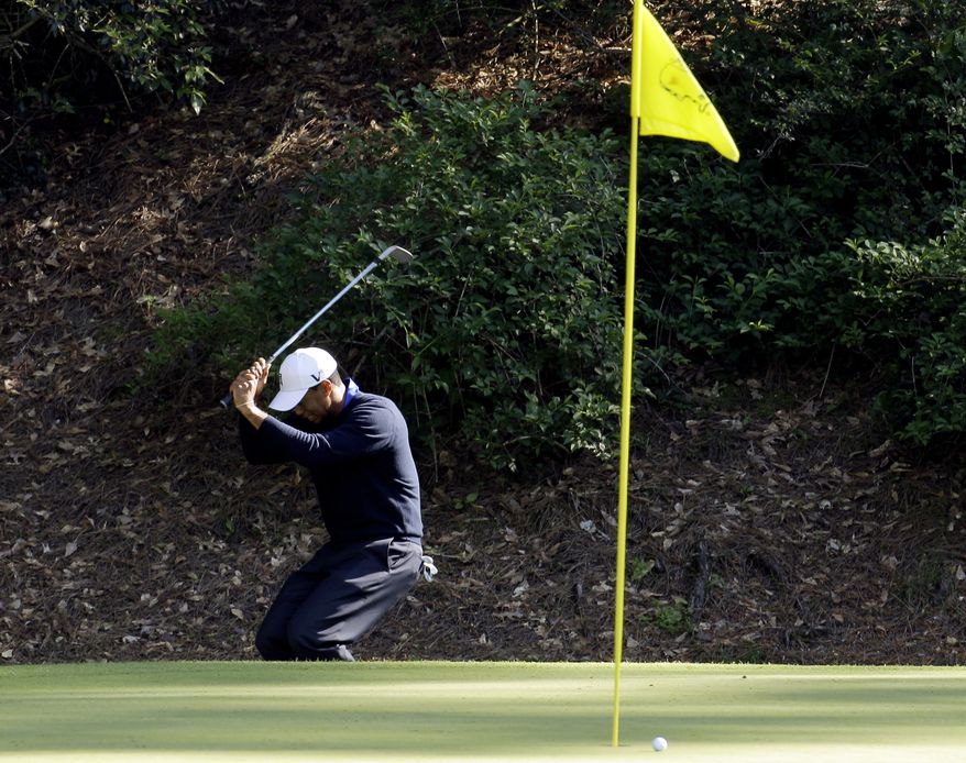 Tiger Woods reacts to missing a birdie chip on the 12th green during the second round of the Masters tournament Friday, April 6, 2012, in Augusta, Ga. (AP Photo/Charlie Riedel)