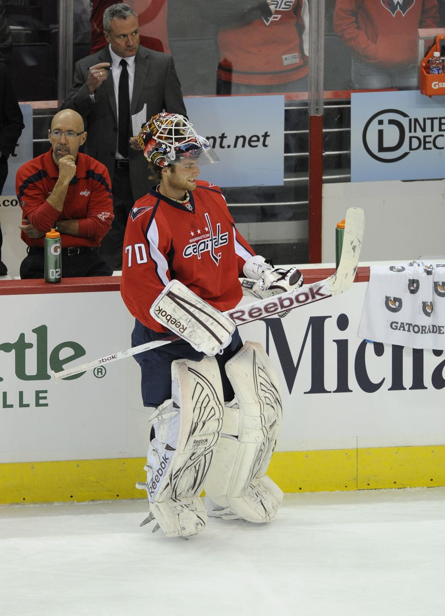 Washington Capitals goaltender Braden Holtby made 12 saves in relief of Michal Neuvirth, who left the game against the Florida Panthers in the second period with a lower-body injury. The Capitals won 4-2. (AP Photo/Nick Wass)