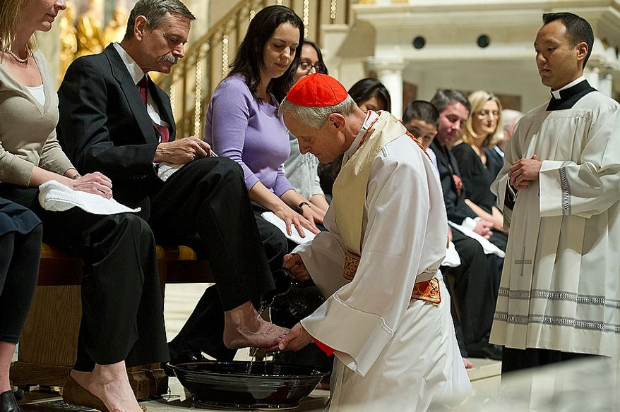 """Cardinal Donald Wuerl, archbishop of Washington, washes the feet of Les Ralston during the Mass of the Lord's Supper at the Cathedral of St. Matthew the Apostle in Washington, D.C., on April 5, 2012, which was Holy Thursday. Ralston was one of 12 church members to have their feet washed, a religious rite that represents Jesus washing his disciples' feet, saying """"A servant is no greater than his master."""" (Barbara L. Salisbury/The Washington Times)"""
