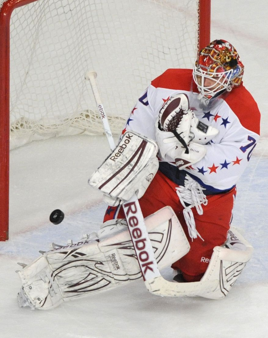 Washington Capitals goaltender Braden Holtby makes a save during the third period of an NHL hockey game against the New York Rangers, Saturday, April 7, 2012, at Madison Square Garden in New York. The Capitals defeated the Rangers 4-1. (AP Photo/Bill Kostroun)