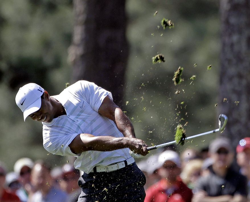 Tiger Woods hits off the first fairway during the third round of the Masters golf tournament Saturday, April 7, 2012, in Augusta, Ga. (AP Photo/Darron Cummings)