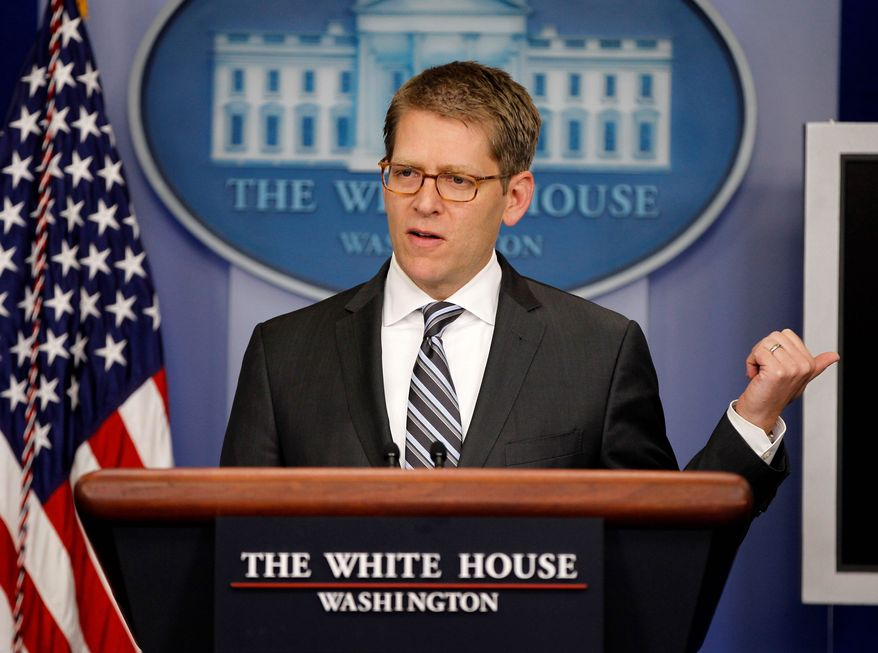 """White House press secretary Jay Carney tries to clear up what President Obama said about health care reform and the Supreme Court during his daily news briefing at the White House on Wednesday. """"You're standing up there twisting yourself in knots,"""" one reporter said to Mr. Carney. (Associated Press)"""