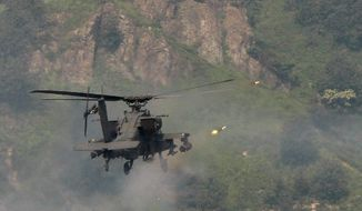 The Army has to rely upon the AH-64 Apache (above) as well as the OH-58 Kiowa Scout because the next-generation Comanche helicopter has been canceled. (Associated Press)