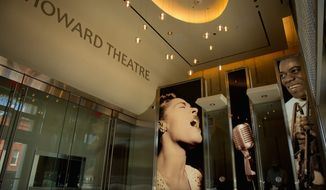 A photograph of Billie Holliday adorns the lobby of the redesigned Howard Theatre in the District, which is set to reopen with a ribbon-cutting Monday and a gala Thursday night. (Andrew Harnik/The Washington Times)