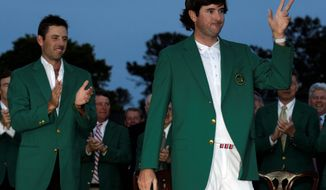 It was a fitting end to the Masters for Bubba Watson, who waves to the crowd Sunday night at the green-jacket ceremony. (Associated Press)