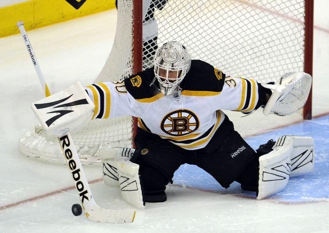 Boston goalie Tim Thomas, the MVP if last year's playoffs, will backstop the Bruins as they begin defense of their championship Thursday against Washington. (AP Photo/Lori Shepler)