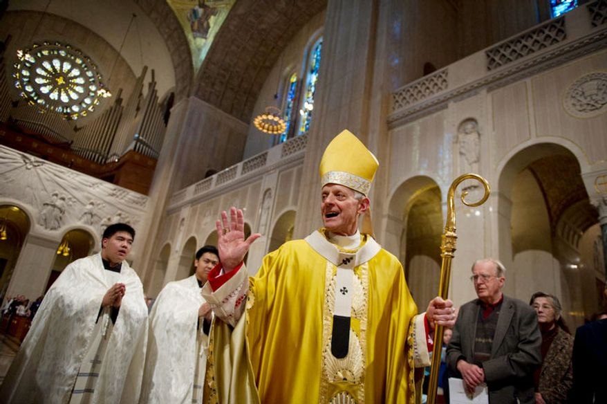 Cardinal Donald Wuerl, Archbishop of Washington, waves to people in the pews as the procession makes it way up the aisle for the Easter Sunday Solemn Mass at the Basilica of the National Shrine of the Immaculate Conception in Washington, D.C., Sunday, April 8, 2012. (Rod Lamkey Jr/The Washington Times)