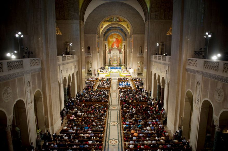 The Basilica is full to capacity during the Easter Sunday Solemn Mass . (Rod Lamkey Jr/The Washington Times)
