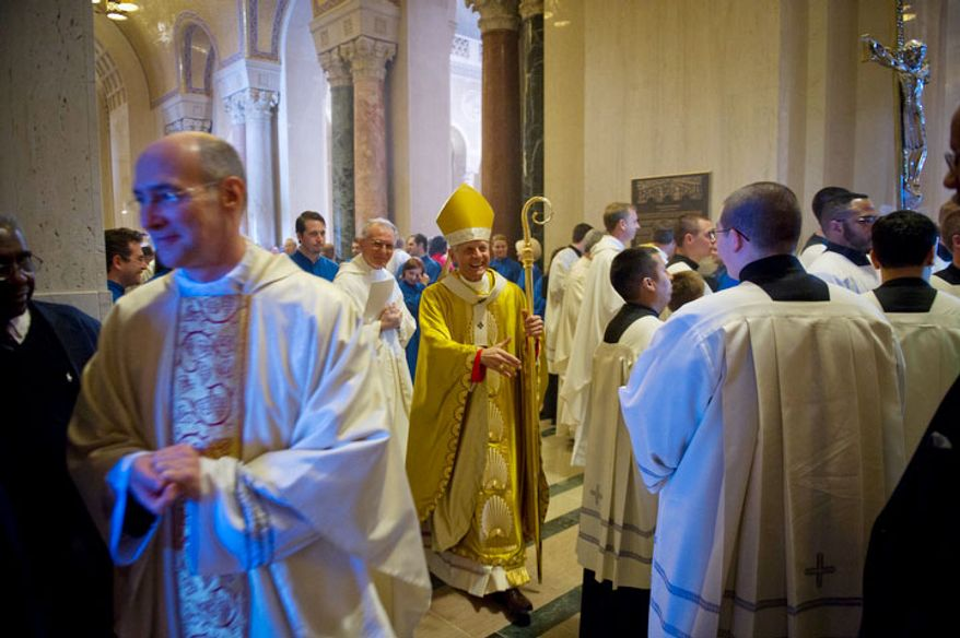 Cardinal Donald Wuerl, Archbishop of Washington greets people as he makes his exit following the Easter Sunday Solemn Mass at the Basilica of the National Shrine of the Immaculate Conception in Washington, D.C., Sunday, April 8, 2012. (Rod Lamkey Jr/The Washington Times)