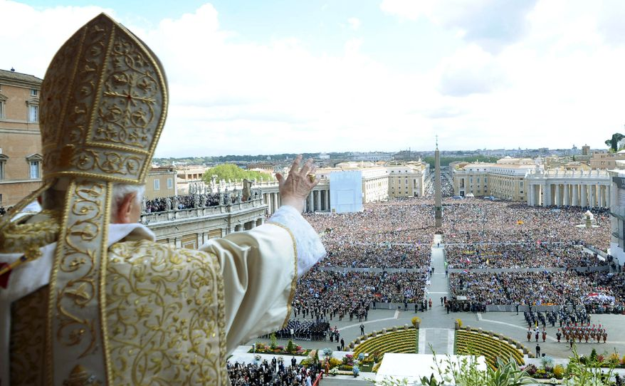 "Pope Benedict XVI greets the faithful after his ""Urbi and Orbi"" (""to the city and the world"") blessing following the Easter Mass in St. Peter's Square at the Vatican on Sunday, April 8, 2012. (AP Photo/Osservatore Romano)"