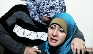 Relatives mourn for Ali Shaaban, a cameraman for the Al Jadeed television station who was filming in Lebanon's northern Wadi Khaled area when he was fatally shot in the chest by Syrian government forces. (Associated Press)