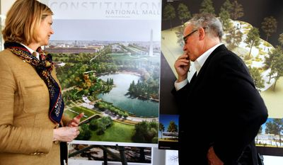 Caroline Cunningham, president of the Trust for the National Mall, and Donald Stastny, an architect advising the group, look over two of the competing proposals for redesigning three areas of the Mall. A winner for each site is to be chosen in May. (Associated Press)