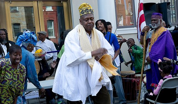 Melvin Deal, center, founding director of the African Heritage Dancers and Drummers, dances at the grand opening of the newly renovated Howard Theatre in Washington, D.C. on Monday, April 9, 2012. (Barbara L. Salisbury/The Washington Times)