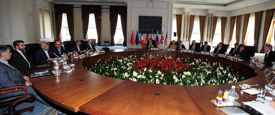 **FILE** Representatives sit around a table Jan. 22, 2011, on the second day talks between Iran and world powers on Iran's nuclear program at the historical Ciragan Palace in Istanbul, Turkey. (Associated Press)