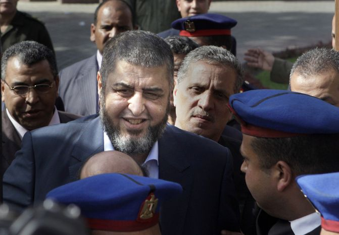 Khairat el-Shater, the Muslim Brotherhood candidate for the Egyptian presidency, leaves the Higher Presidential Elections Commission after submitting his candidacy papers in Cairo on Friday, April 5, 2012. (AP Photo/Amr Nabil)
