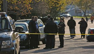 Police investigate the scene of a shooting in which three people were killed at an in-home day care in Brooklyn Park, Minn., on Monday, April 9, 2012. (AP Photo/The Star Tribune, Richard Sennott)
