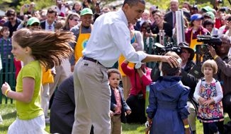 President Obama attends the opening of the Easter Egg Roll festivities at the White House on April 9, 2012. (Associated Press)