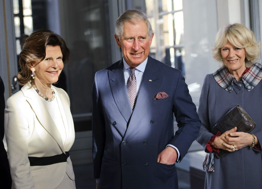 Sweden's Queen Silvia (left) welcomes Britain's Prince Charles and his wife, the Duchess of Cornwall, at the Royal Palace in Stockholm on Thursday, March 22, 2012. (AP Photo/Scanpix, Henrik Montgomery)