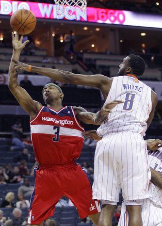 Washington Wizards' James Singleton (3) is fouled by Charlotte Bobcats' D.J. White (8) during the second half of an NBA game in Charlotte, N.C., Monday, April 9, 2012. Washington won 113-85. (AP Photo/Chuck Burton)