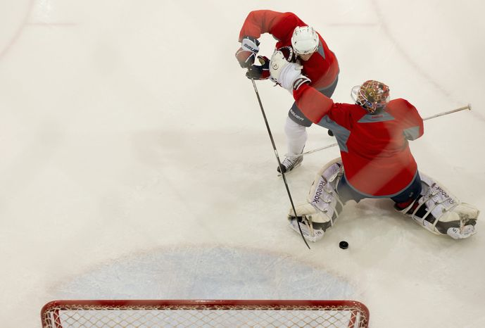 Capitals center Brooks Laich tries to score on goalie Braden Holtby during practice. Holtby has assumed the starter's role after injuries to Tomas Vokoun and Michal Neuvirth. (Andrew Harnik/The Washington Times)