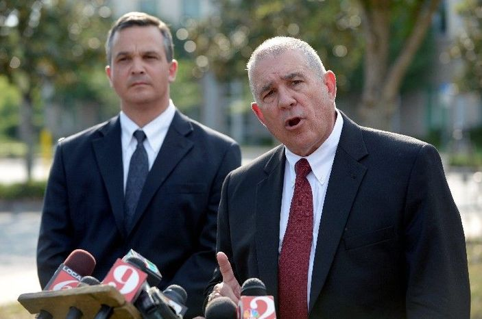 """Hal Uhrig (right) and Craig Sonner withdrew as defense attorneys for George Zimmerman, the man who claims self-defense in the fatal shooting of black teenager Trayvon Martin in Sanford, Fla. """"We're concerned for his emotional and physical safety,"""" Mr. Uhrig said at a Tuesday news conference, saying that their client had cut off all contact and that he had left the state. (Associated Press)"""