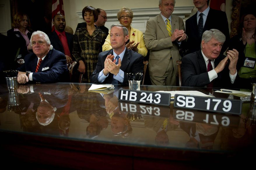 Maryland Gov. Martin O'Malley is flanked by state Senate President Thomas V. Mike Miller Jr. (left) and House Speaker Michael E. Busch during a bill signing Tuesday. The General Assembly closed at midnight Monday with no budget passed, so automatic cuts will kick in unless the governor calls a special session before July 1. (Rod Lamkey Jr./The Washington Times)