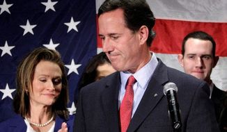 Rick Santorum turns to his wife, Karen, on Tuesday after announcing in Gettysburg, Pa., that he is suspending his run for president. Front-runner Mitt Romney said in Delaware that he will now start seriously pondering a list of vice-presidential prospects. (Associated Press)