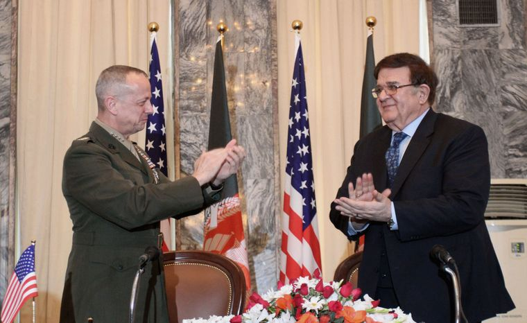 Gen. John Allen (left), the top commander of U.S. and NATO forces in Afghanistan, claps with Afghan Defense Minister Gen. Abdul Rahim Wardak on April 8, 2012, in Kabul, Afghanistan, after signing an agreement document governing night raids by American troops. (Associated Press)