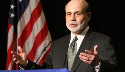 Federal Reserve Chairman Ben S. Bernanke speaks at the 2012 Financial Markets Conference sponsored by the Federal Reserve Bank of Atlanta at the Stone Mountain Evergreen Convention Center outside Atlanta on Monday, April 9, 2012. (AP Photo/Atlanta Journal & Constitution, Phil Skinner)
